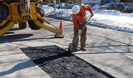 Pothole patch repair with Unique Paving Materials